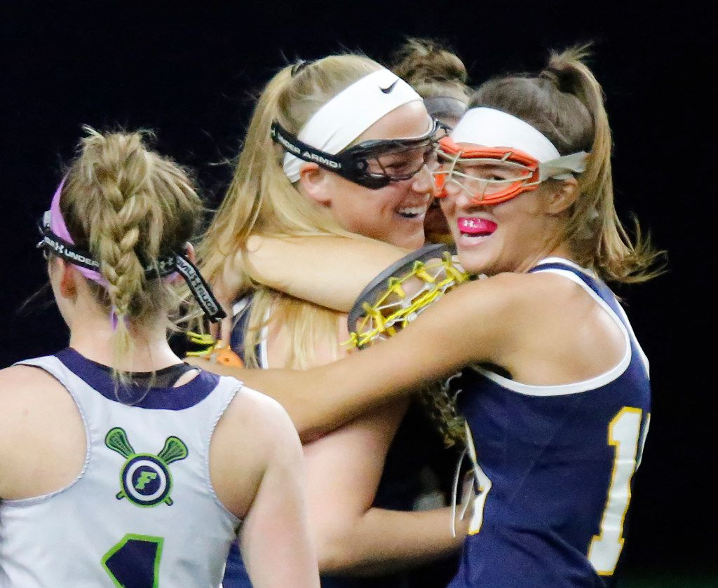 Highland Parks's Kennedy Cox (left), Mira Martin (center) and P.J. Van den Branden (right) celebrate the goal to put them ahead 4-0 in front of Frisco's Madison Altieri (1) during the first half as Highland Park played the Frisco Fury as part of the Patriot Cup lacrosse tournament at The Ford Center at The Star in Frisco on Saturday, February 18, 2017. (Stewart F. House/Special Contributor)