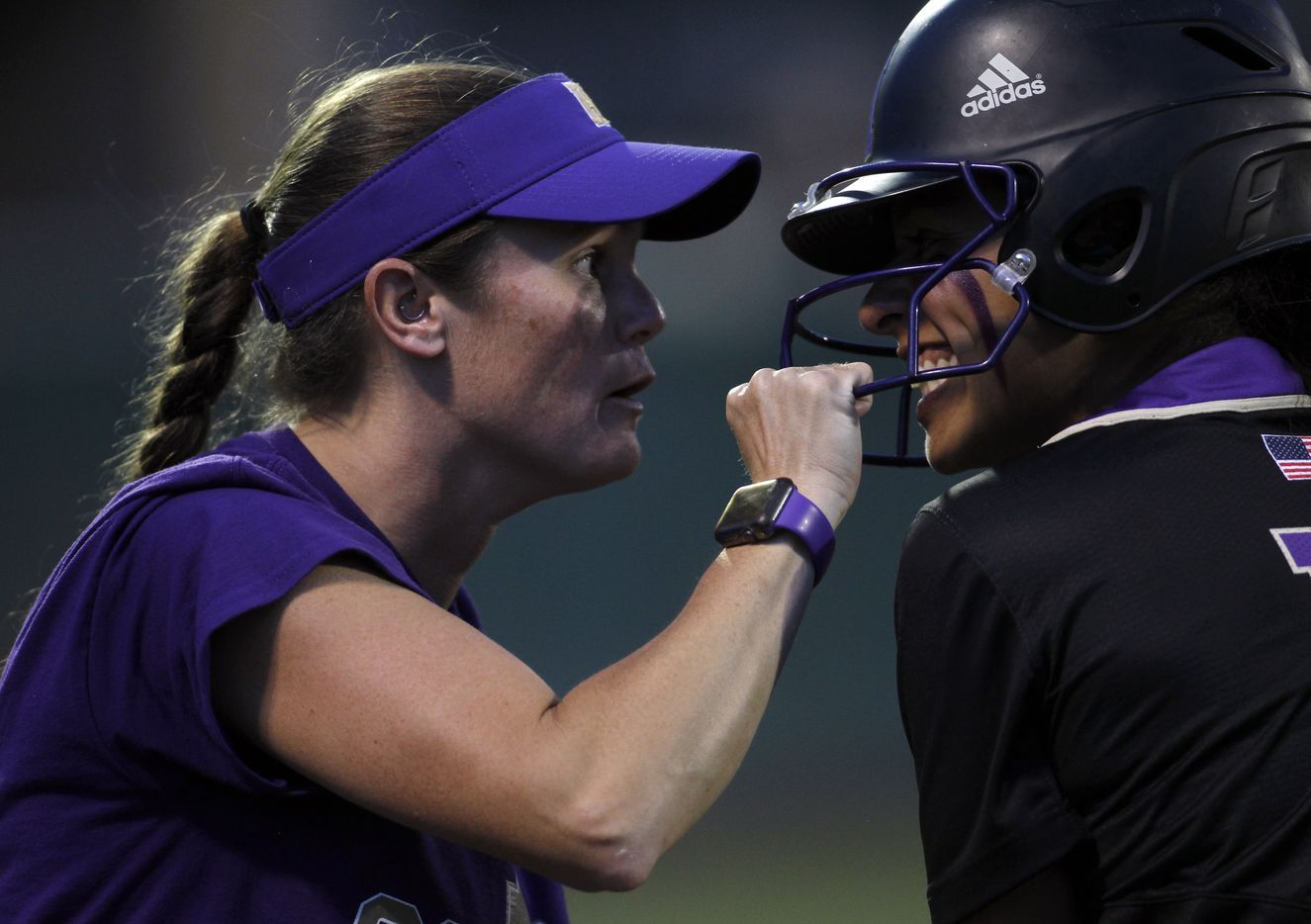 Hallsville assistant coach Sarah Hendrix, left, celebrates with outfielder Lily Soto (13) at first base after her RBI single in the top of the 3rd inning of play against Lovejoy. Game 2 of a best-of-3 Class 5A Region ll final series softball playoff game was  held at Rockwall High School in Rockwall on May 27, 2021. (Steve Hamm/ Special Contributor)