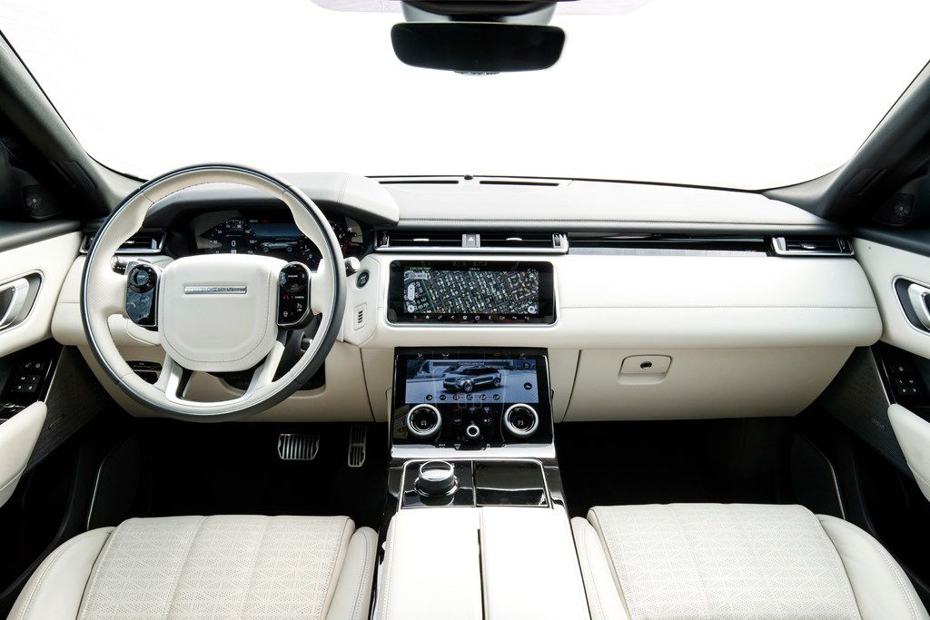 The Velar's interior is sleek, with  two 10-inch capacitive touchscreens that the company calls InControl Touch Pro Duo.