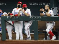 Texas Rangers manager Chris Woodward (second from right) and bench coach Dave Wakamatsu (third from right) listen to second baseman Rougned Odor (right) during the ninth inning against the Seattle Mariners at Globe Life Field in Arlington, Monday, August 10, 2020.