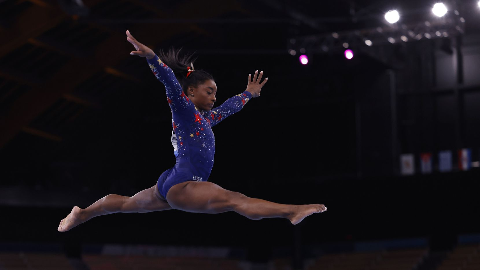 USA's Simone Biles competes on the balance beam in a women's gymnastics event during the postponed 2020 Tokyo Olympics at Ariake Gymnastics Centree on Sunday, July 25, 2021, in Tokyo, Japan.
