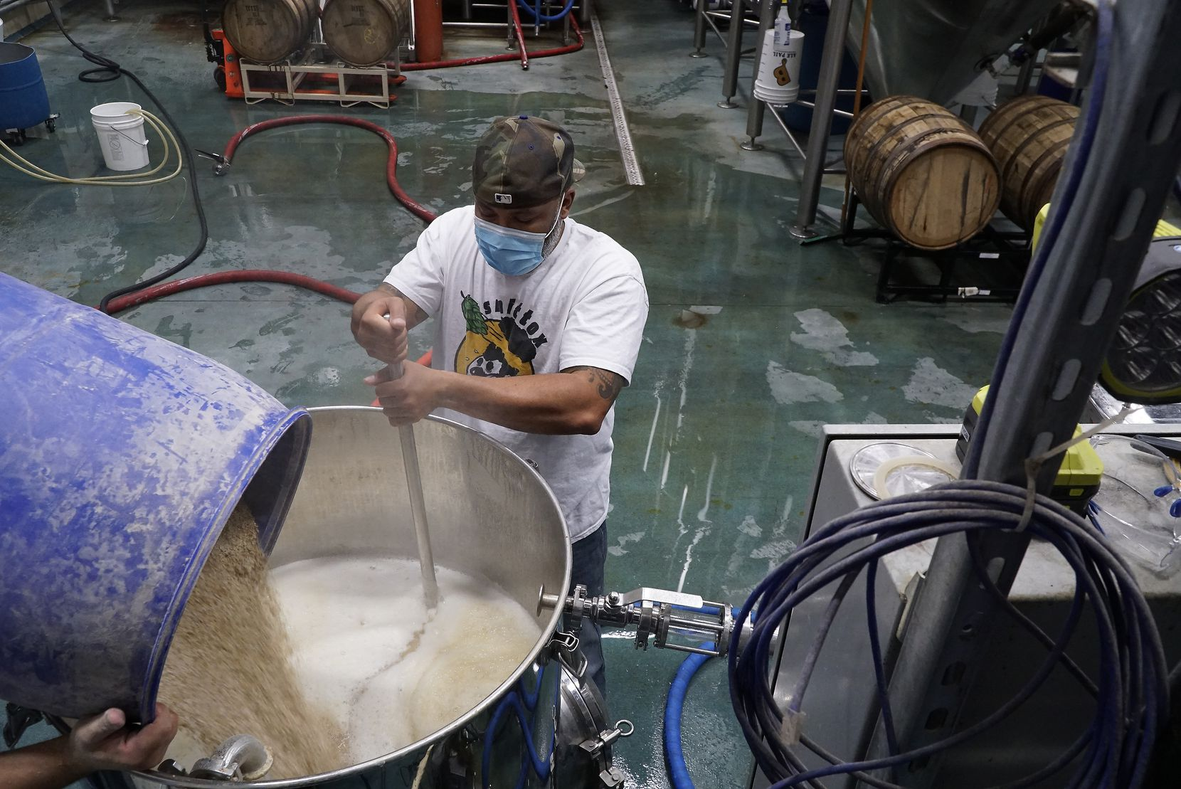 Kuumba Smith mashes the grain for a kettle sour beer at Hop & Sting Brewing Co. in Grapevine.