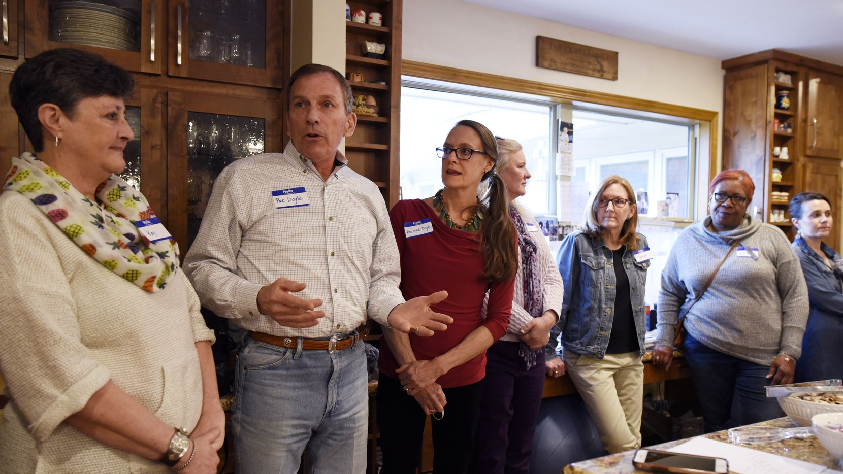 Pat Doyle (second from left) and his wife, Dianne (in red shirt), hosted a plant-based potluck at their North Dallas home earlier this year, before social distancing rules.