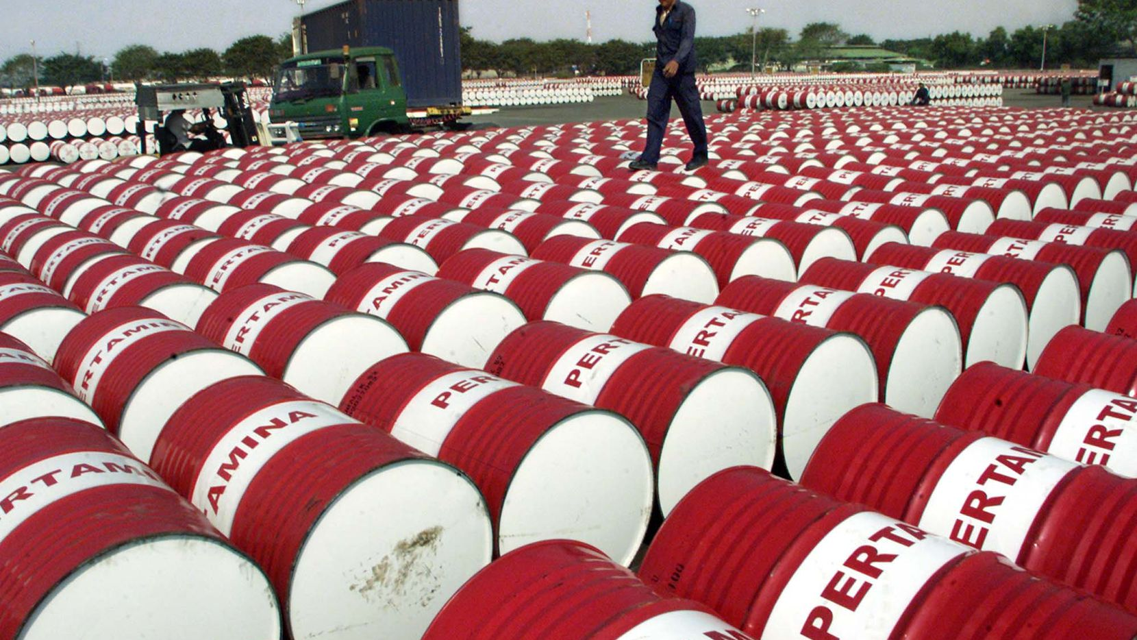 An Indonesian worker walks on barrels of oil at a distribution station of the state-owned oil company Pertamina in Jakarta, Indonesia, in 2005. The question is not if the world will start running out of oil, but when. Top OPEC producers, major oil companies and others in the oil establishment insist crude will be plentiful for at least another generation, but critics argue that OPEC's reserves are overstated, recovery possibilities are limited and the day that demand starts to outstrip supply may soon be upon us.