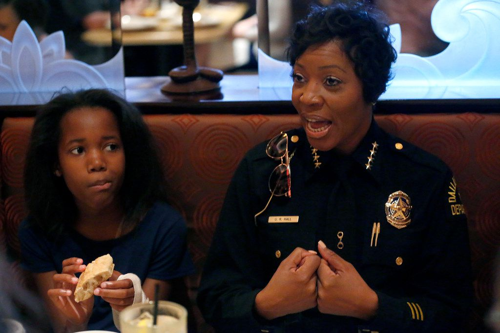 Lauren Walker, 11, listens to Dallas Police Chief U. Renee Hall during  lunch with four students from Scofield Christian School at the Cheesecake Factory in Dallas on June 8, 2018.  In April, Scofield Christian School  held its Annual Fund Dinner, which helps provide necessary funds to fill the gap between tuition and the actual cost of the school. During the Annual Fund Dinner, parents participated in a silent auction filled with items donated by local families and businesses. As one of the auction items, SCS donors provided lunch at the Cheesecake Factory and a limo ride for Chief Hall and four students.