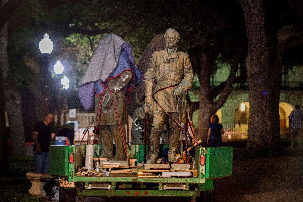 The statues depicting Robert  E. Lee, Albert Sidney Johnston, John Reagan and James Stephen Hogg were removed from the Main Mall at the University of Texas at Austin early Monday.