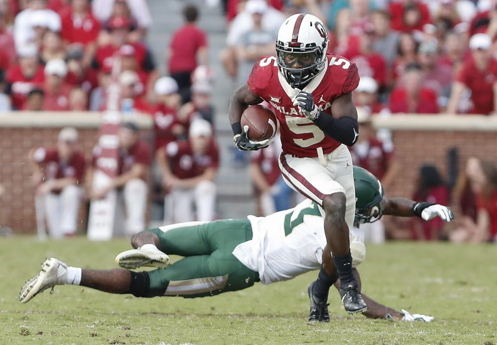 Oklahoma wide receiver Marquise Brown (5) runs ahead of Baylor safety Chris Miller (3) in the second half of an NCAA college football game in Norman, Okla., Saturday, Sept. 29, 2018. Oklahoma won 66-33.