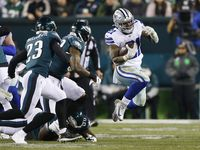 Dallas Cowboys running back Ezekiel Elliott (21) leaps to evade a tackle from Philadelphia Eagles nose tackle Anthony Rush (66) as the rest of the Philadelphia Eagles defense closes in on him during the second half of play at Lincoln Financial Field in Philadelphia on Sunday, December 22, 2019. Philadelphia Eagles defeated the Dallas Cowboys 17-9.