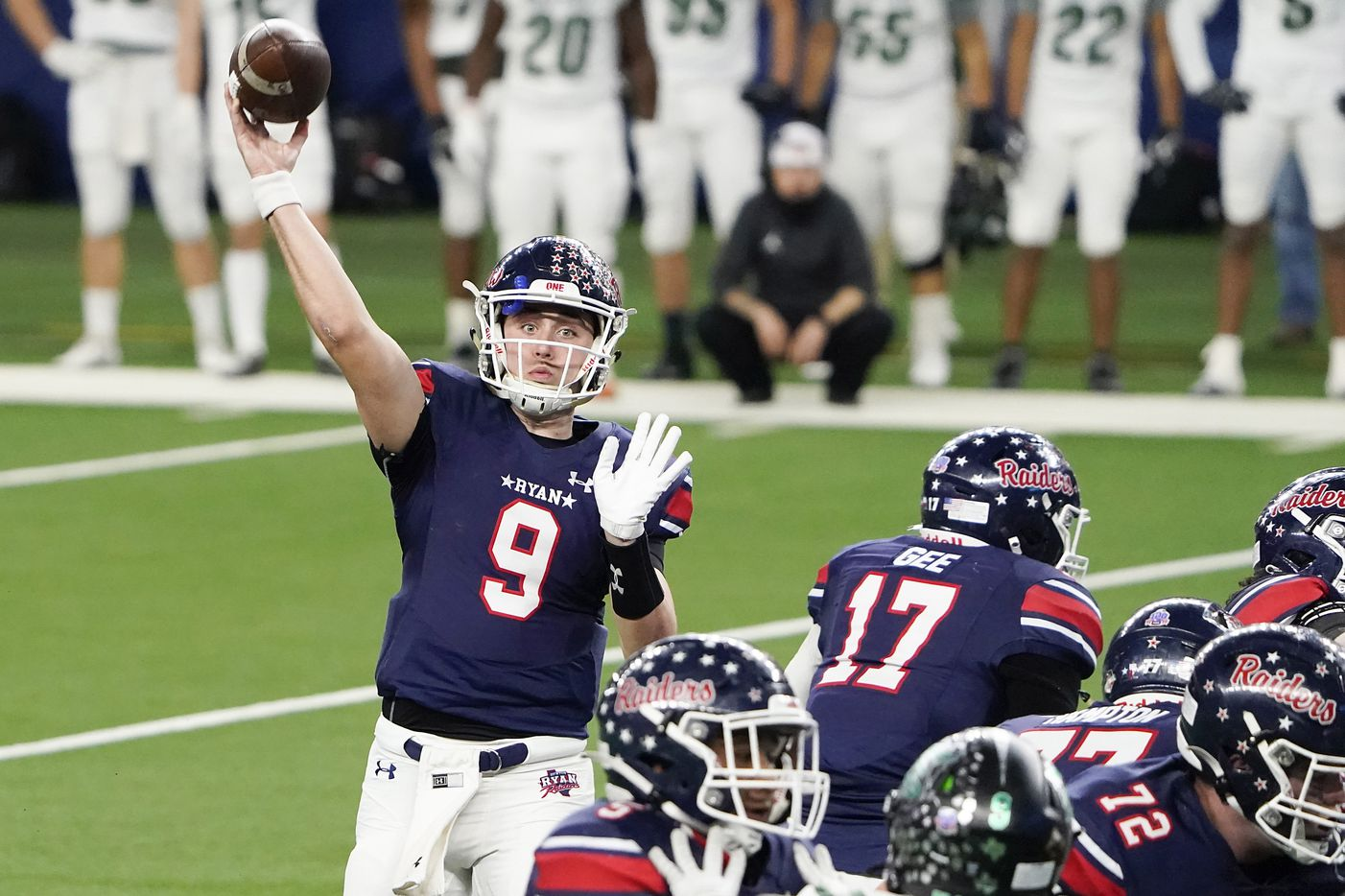 Denton Ryan quarterback Seth Henigan (9) throws a touchdown pass to Ja'Tavion Sanders during the second half of the Class 5A Division I state football championship game against Cedar Park at AT&T Stadium on Friday, Jan. 15, 2021, in Arlington, Texas. Ryan won the game 59-14. (Smiley N. Pool/The Dallas Morning News)