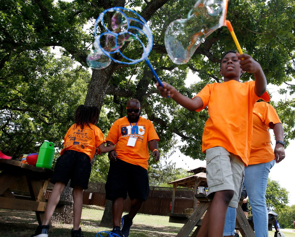 Olivia Johnson (right), 9, played with bubbles during the Black Trans Advocacy Coalition's Family Picnic at Circle R Ranch in Flower Mound on April 28.