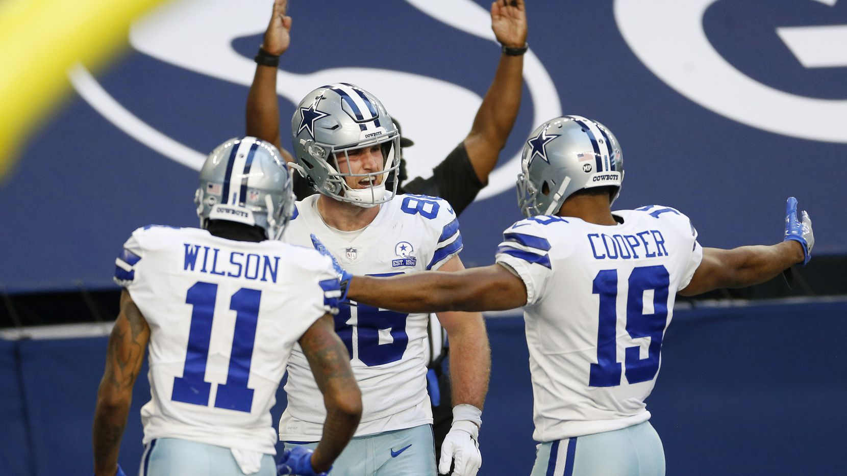 Cowboys tight end Dalton Schultz (86) is congratulated by teammates Cedrick Wilson (11) and Amari Cooper (19) after scoring a touchdown against the 49ers at AT&T Stadium on Sunday, Dec. 20, 2020, in Arlington.