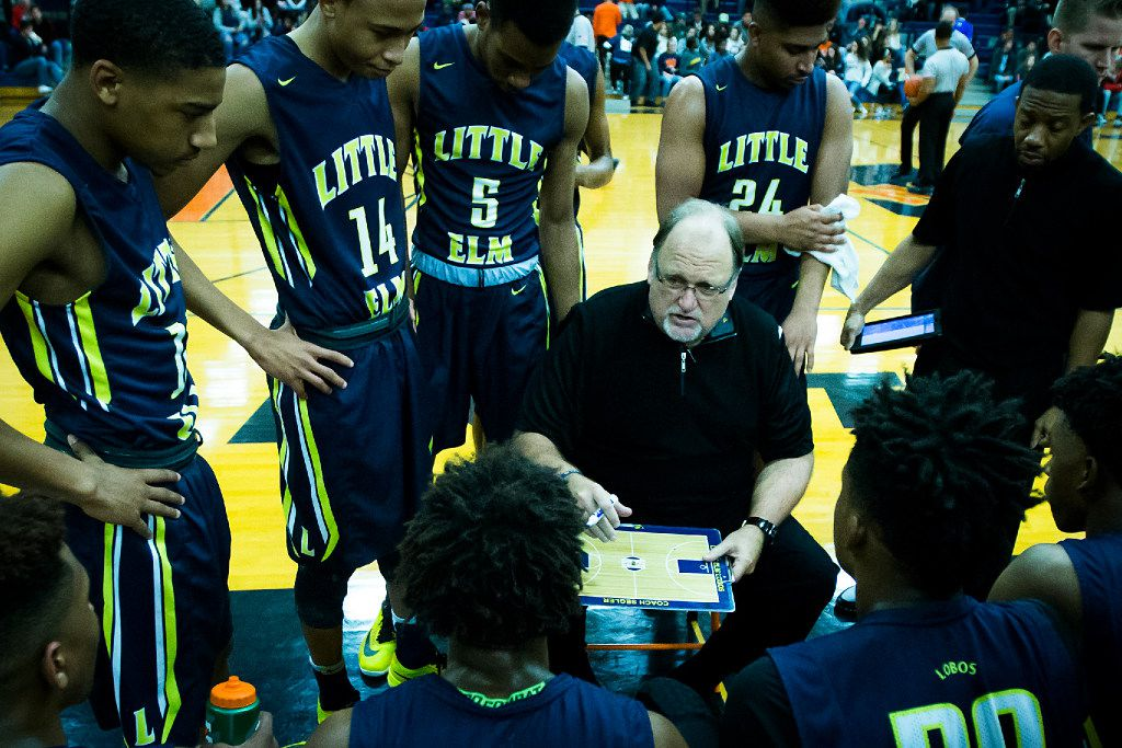Little Elm boys basketball coach Rusty Segler works with his team during a timeout in a game in 2017. (Smiley N. Pool/The Dallas Morning News)