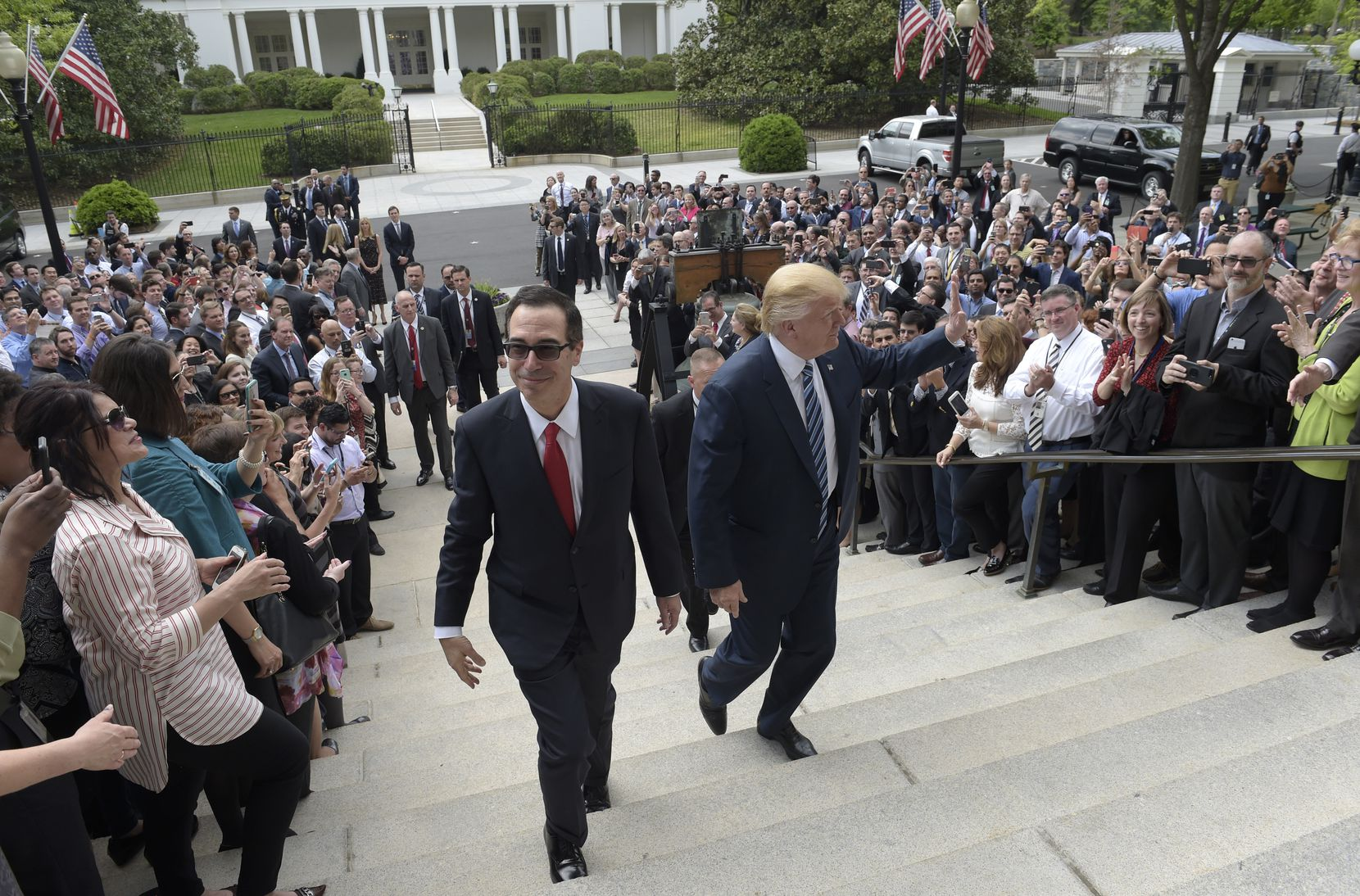 President Donald Trump and Treasury Secretary Steven Mnuchin arrive at the Treasury Department in Washington, Friday, April 21, 2017, where the president was to sign an executive order to review tax regulations set last year by his predecessor, as well as two memos to potentially reconsider major elements of the 2010 Dodd-Frank financial reforms passed in the wake of the Great Recession.