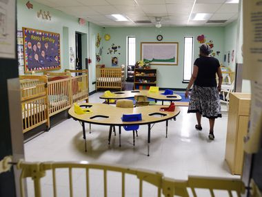 Dr. Ora Watson, owner and director of For Keeps Sake Child Care Academy, walks through an empty infant classroom at her child care academy in Dallas.