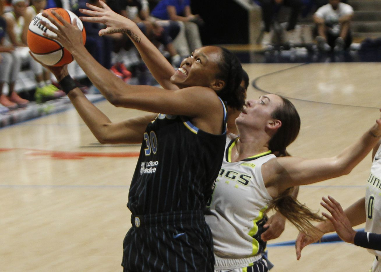 Chicago Sky forward Azura Stevens (30) drives and shoots as Dallas Wings guard Marina Mabrey (3) defends during second half action. Dallas defeated Chicago 100-91. The two WNBA teams played their game at College Park Center in Arlington on July 2, 2021. (Steve Hamm/ Special Contributor)