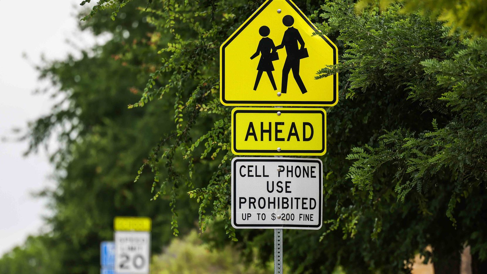A warning notice not to use cellular devices around school grounds is displayed near Ereckson Middle School in Allen on Wednesday, June 9, 2021.