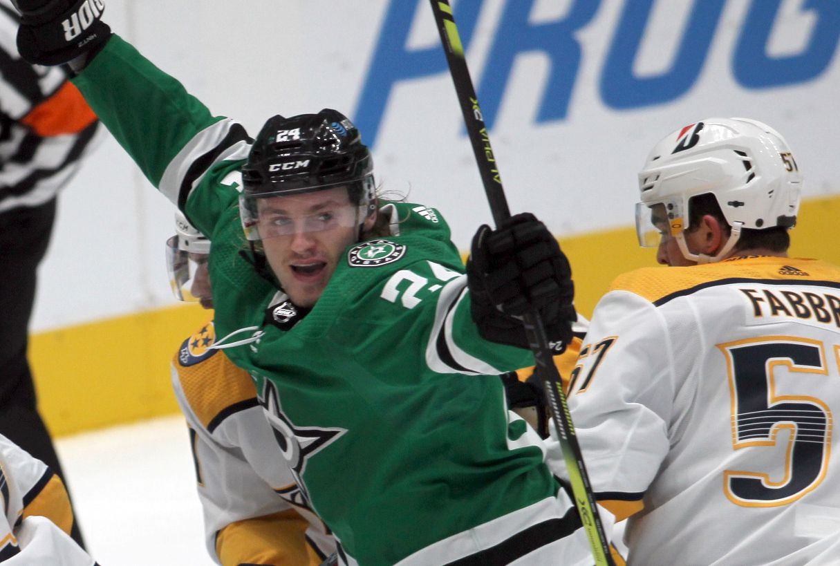 Dallas Stars forward Roope Hintz (24) celebrates his goal as Nashville Predators defenseman Dante Fabbro (57) can only look on during second period play. The two teams played their NHL game at the American Airlines Center in Dallas on January 24 , 2021. (Steve Hamm/ Special Contributor)