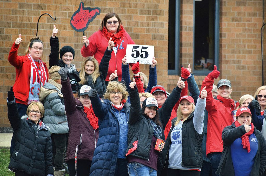 Teachers give a thumbs-up in front of Woodsdale Elementary in Wheeling, W.Va., Tuesday, March 6, 2018, after teachers across the state received notice that a deal was reached to end the teacher walkout that has closed the state's public schools since Feb. 22. (Scott McCloskey/Wheeling News Register & The Intelligencer)