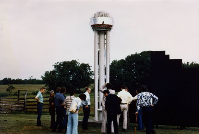 Ray Hunt (in sunglasses) and John Scovell (in plaid pants) had a 16-foot model of Reunion Tower built on the Henry C. Beck farm in 1975. The mock-up prevented sneak previews of the real thing.