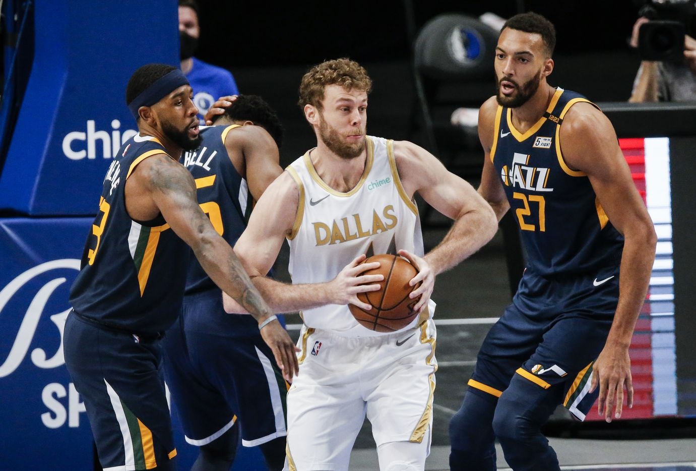 Dallas Mavericks forward Nicolo Melli (44) looks to pass as Utah Jazz forwards Royce O'Neale, left, and Rudy Gobert (27) defend during the first half of an NBA basketball game in Dallas, Monday, April 5, 2021. (Brandon Wade/Special Contributor)