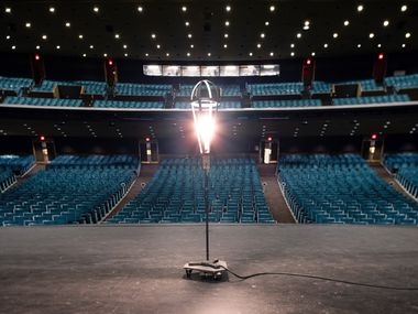 A ghost light onstage at the empty Music Hall at Fair Park in Dallas on Thursday, Feb. 4, 2021. (Juan Figueroa/ The Dallas Morning News)