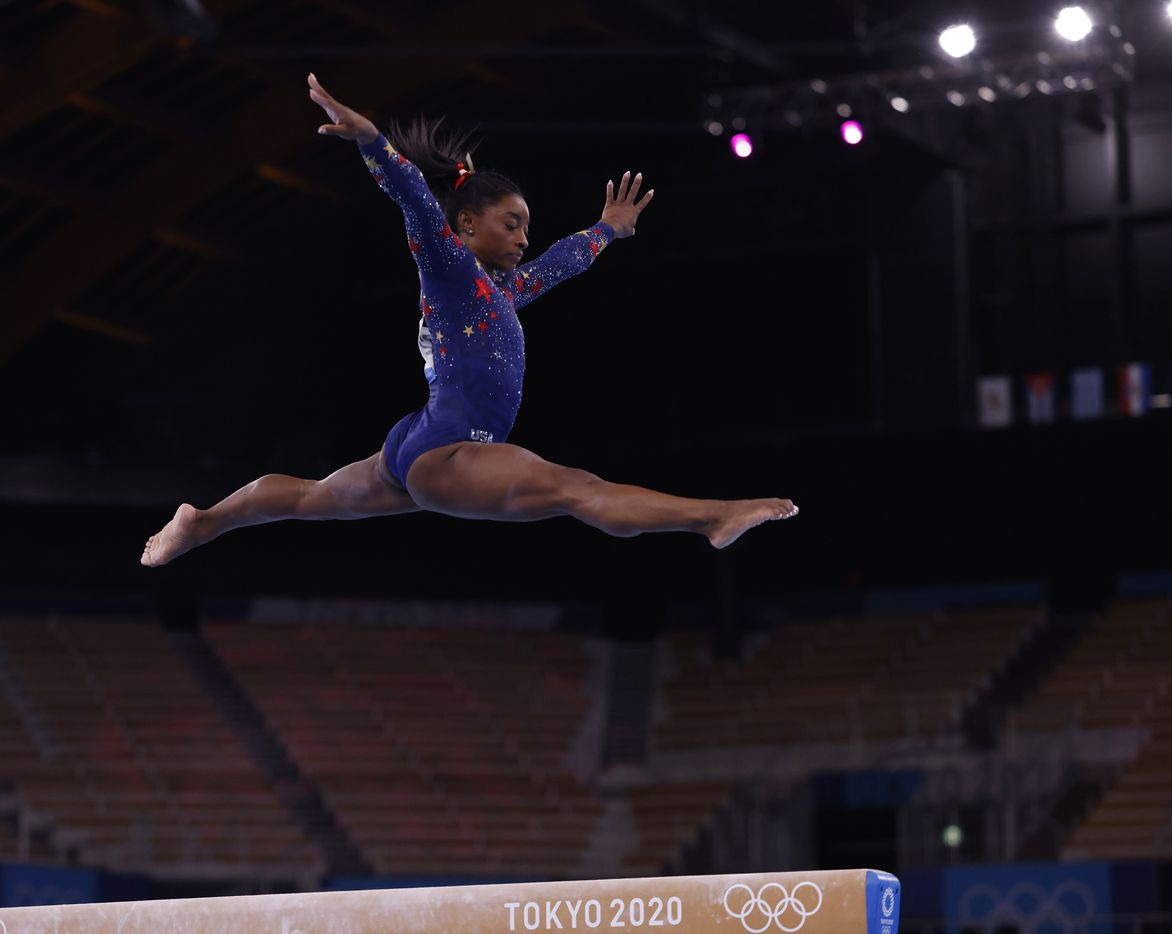 USA's Simone Biles competes on the balance beam in a women's gymnastics event during the postponed 2020 Tokyo Olympics at Ariake Gymnastics Centree on Sunday, July 25, 2021, in Tokyo, Japan. (Vernon Bryant/The Dallas Morning News)