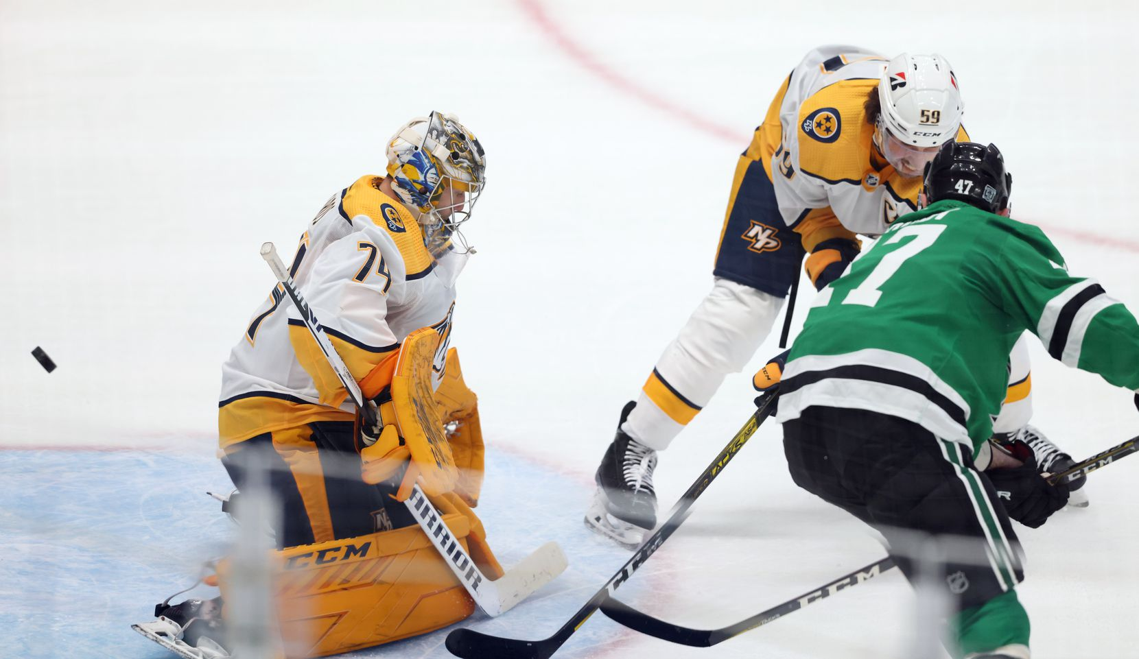 Dallas Stars right wing Alexander Radulov (47) scores his second goal of the game on Nashville Predators goaltender Juuse Saros (74) as Nashville Predators defenseman Roman Josi (59) closes in on the play during the second period of play in the Stars home opener at American Airlines Center on Friday, January 22, 2021in Dallas. (Vernon Bryant/The Dallas Morning News)