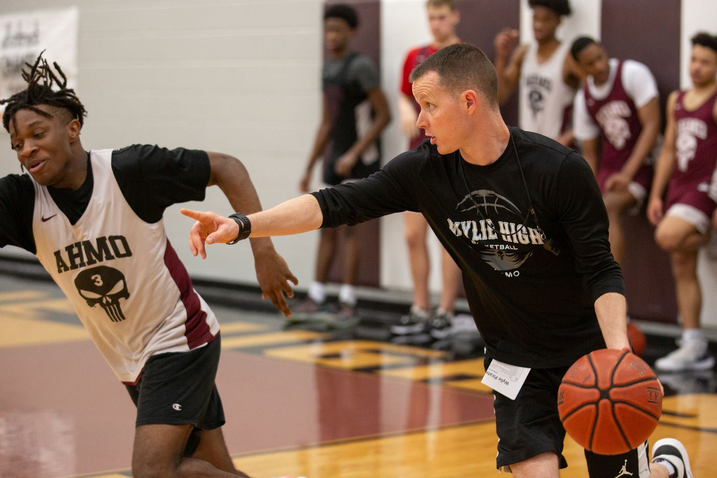 Wylie High School head basketball coach Stephen Pearce plays in a drill during practice at Wylie High School on March 11, 2020 in Wylie, Texas. (Kara Dry/Special Contributor)