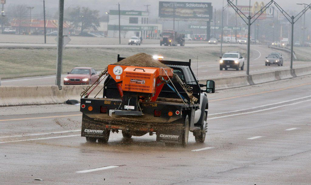 A sand truck spreads sand on southbound Hwy. 67 near the Red Bird Lane exit on February 28, 2019 in Dallas. Freezing temperature and wet conditions overnight led to icy roads, causing dozens of accidents.