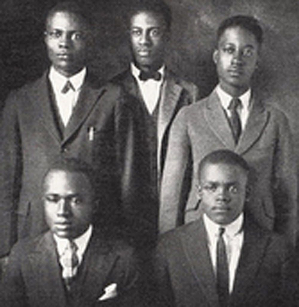 This photo shows Melvin B. Tolson (center) and members of the 1935 Wiley College debate team that prevailed over the nationally known University of Southern California during a debate in California. The accomplishments of Wiley's debate team under the leadership of noted poet Tolson inspired a 2007 movie starring Denzel Washington.