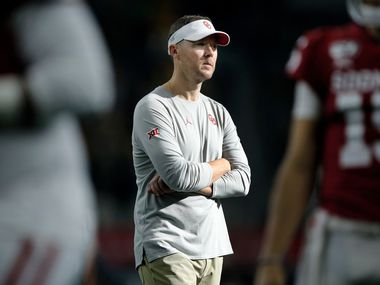 Oklahoma Sooners head coach Lincoln Riley watches his team during warmup before facing the Baylor Bears in the Big 12 Championship at AT&T Stadium in Arlington, Saturday, December 7, 2019. (Tom Fox/The Dallas Morning News)