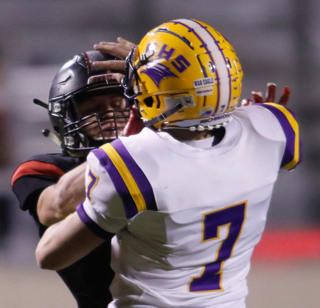 Richardson quarterback Luke Mulvey (7), right, tries to fend off the aggressive rush from Lake Highlands linebacker Caleb Parker (7) after releasing a pass during second quarter action. Mulvey left the game injured after receiving medical attention from team trainers. The two teams played their District 8-6A football game at Wildcat-Ram Stadium on the campus of Lake Highlands High School in Dallas on November 8, 2019. (Steve Hamm/ Special Contributor)