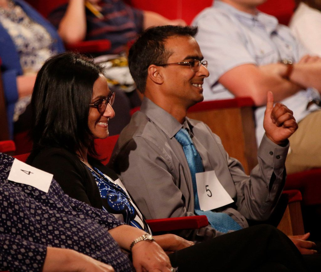 Zaira Jorai-Khan and her husband, Imran Khan, quietly cheer on their daughter, Amira Khan of Cooke County, after she correctly spells a word. (Rose Baca/The Dallas Morning News)