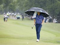 Jordan Spieth walks up to the green in the rain on the 9th hole during round 4 of the AT&T Byron Nelson  at TPC Craig Ranch on Saturday, May 16, 2021 in McKinney, Texas.