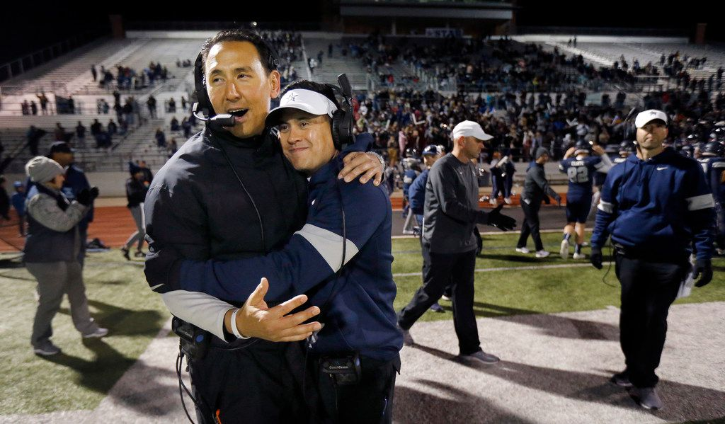 Frisco Lone Star head coach Jeff Rayburn (right) is congratulated by offensive coordinator Mark Humble after defeating Lancaster, 38-20, in their Class 5A Division I Regional championship at Wilkerson-Sanders Stadium in Rockwall, Texas, Friday, December 6, 2019. (Tom Fox/The Dallas Morning News)