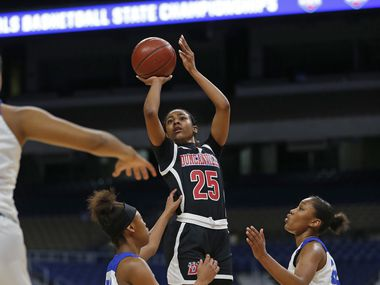Duncanville's Deja Kelly (25) hits a shot against Cypress Creek during Duncanville's 63-47 win in the Class 6A state championship game on March 7 at the Alamodome in San Antonio. Kelly scored 23 points and was named the game's MVP.
