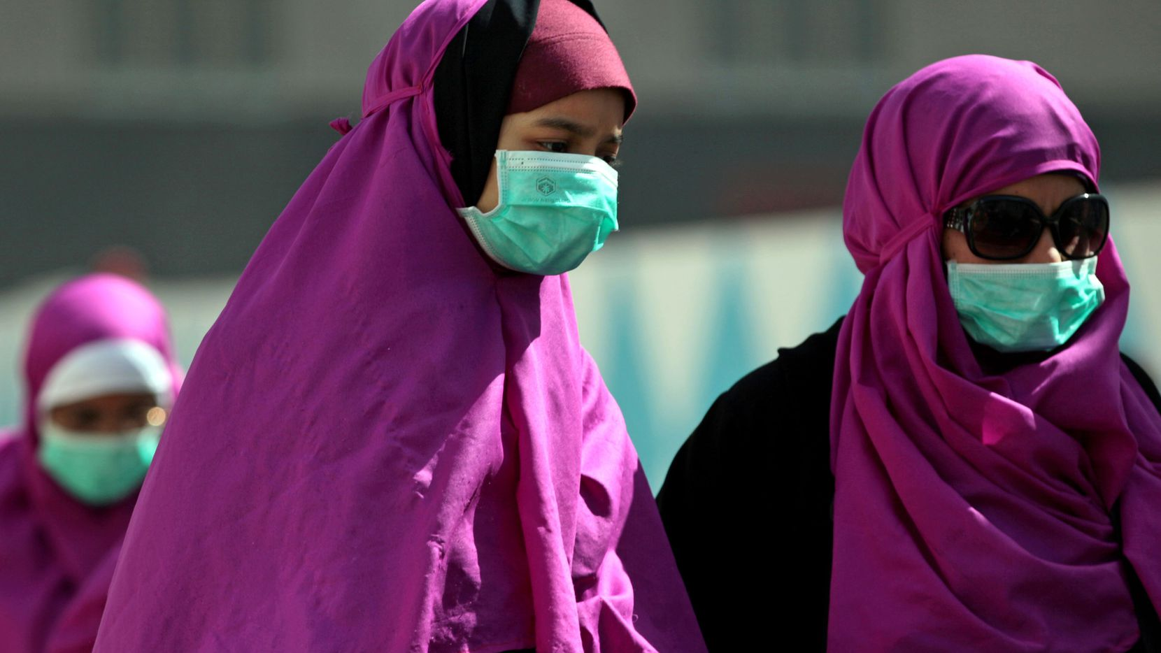 Muslim pilgrims wear surgical masks to prevent infection from respiratory virus MERS in the holy city of Mecca, Saudi Arabia. Officials in Saudi Arabia are raising alarm that the kingdom is not doing enough to prevent Mecca from becoming a route for exporting an often deadly respiratory virus.