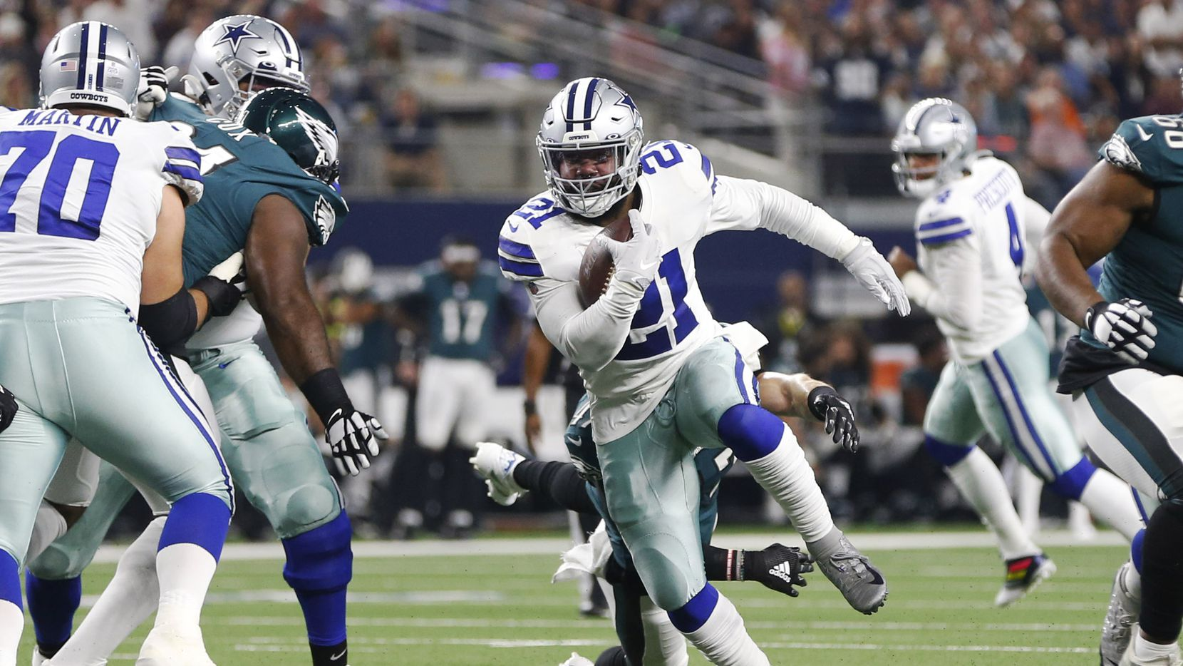 Dallas Cowboys running back Ezekiel Elliott (21) rushes up the field in a game against the Philadelphia Eagles during the first half of play at AT&T Stadium in Arlington, Texas on Sunday, October 20, 2019.