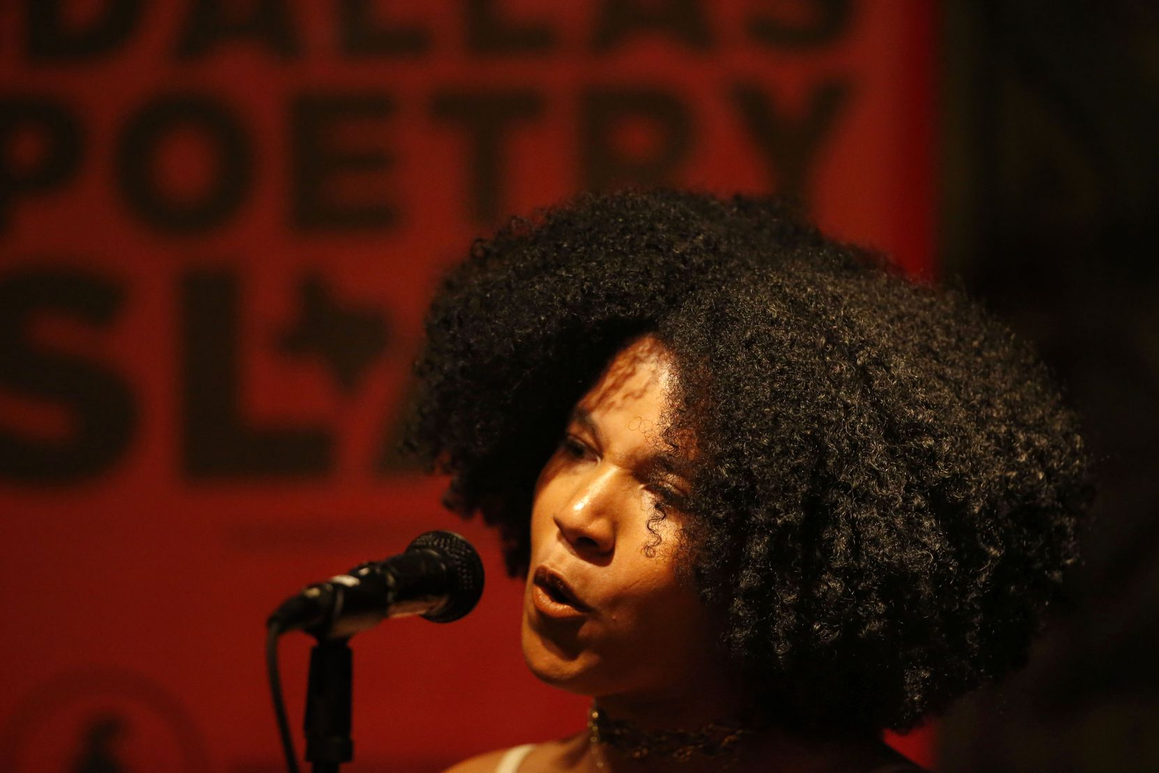 Melania-Luisa Marte performed during an open mic poetry night organized by the Dallas Poetry Slam at Checkered Past Winery and Wine Pub in Dallas on Sept. 25, 2018. Many local poets say they've missed performing in front of a crowd during the pandemic.