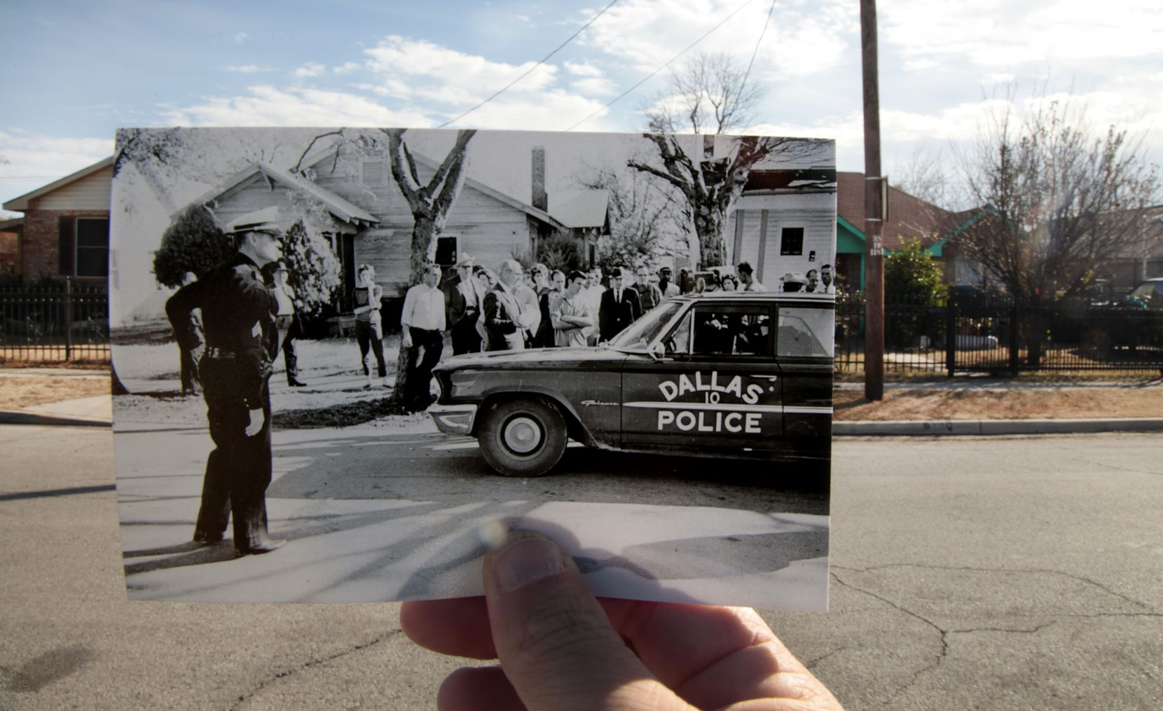 A 1963 photo by Darryl Heikes of the Dallas Times Herald is held up against the spot where J.D. Tippit was shot.
