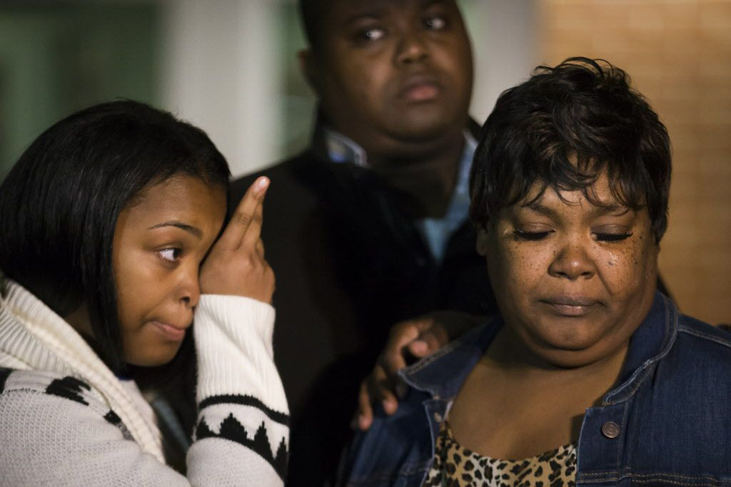 Jacqueline Craig (right) spoke out at a news conference Thursday with her 15-year old daughter and cousin Rod Smith outside the Fort Worth Police Department. (Smiley N. Pool/Staff Photographer)
