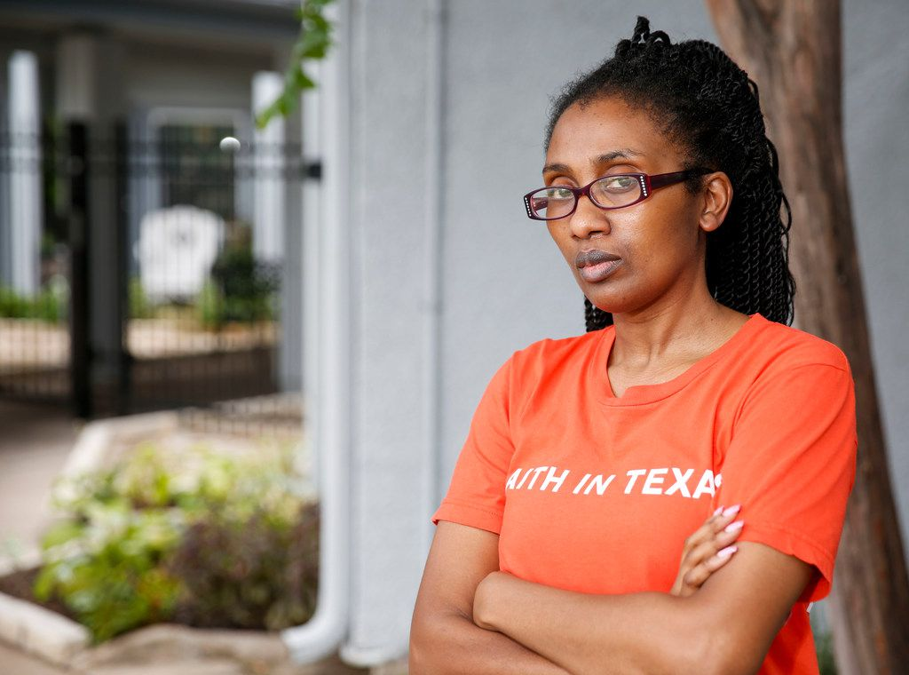 Latosha Lewis, one of nearly 4.3 million people of color with medical debt in Texas, poses in Dallas on Friday, Sept. 20, 2019. She is a home health aide who can't afford health insurance on her $8-an-hour pay, so she went to the hospital when the pain became unbearable.