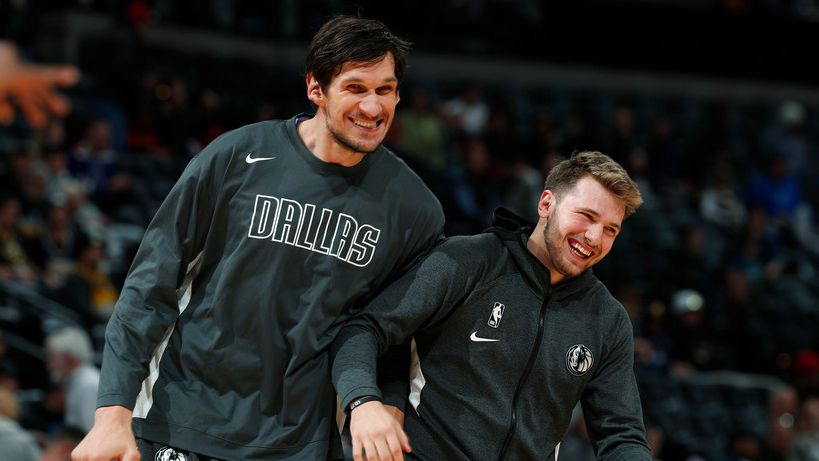 FILE — Dallas Mavericks center Boban Marjanovic, left, jokes with Dallas Mavericks forward Luka Doncic as they warm up before facing the Denver Nuggets in the first half of an NBA basketball game, Tuesday, Oct. 29, 2019, in Denver.