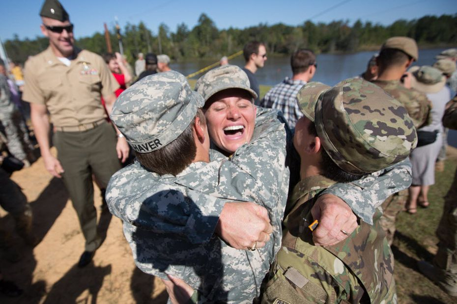 Maj. Lisa Jaster (center) embraced First Lt. Shaye Haver (left) and Capt. Kristen Griest after an Army Ranger School graduation ceremony in 2015 at Fort Benning, Ga.  Jaster  joined Griest and Haver as the third woman to complete the school.