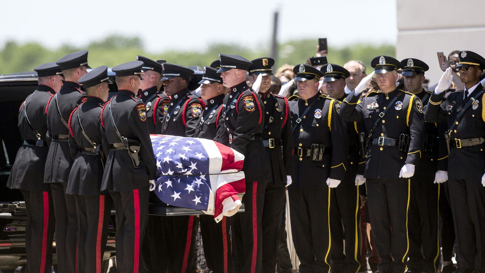 Honor guard members carried the casket of Grand Prairie officer A.J. Castaneda during funeral services at the Potter's House on Thursday, June 13, 2019, in Dallas. Castaneda was killed June 7 while on the George Bush Turnpike.