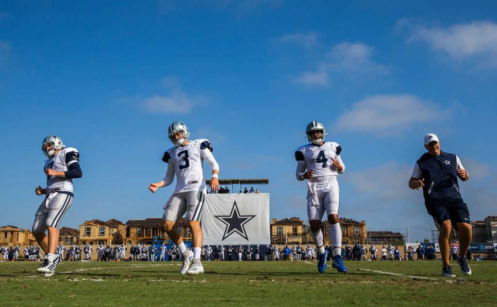 Dallas Cowboys quarterback Cooper Rush (7), quarterback Mike White (3) quarterback Dak Prescott (4) and quarterback coach Jon Kitna run during an afternoon practice at training camp in Oxnard, California on Monday, August 12, 2019. (Ashley Landis/The Dallas Morning News)