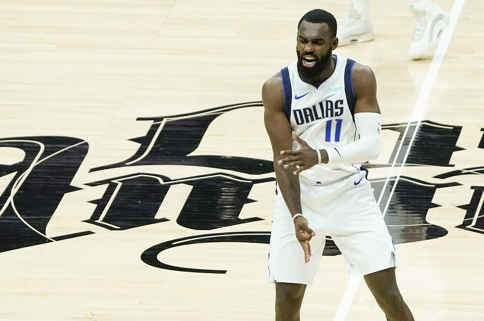 Dallas Mavericks forward Tim Hardaway Jr. (11) celebrates after hitting a 3-pointer during the third quarter of an NBA playoff basketball game against the LA Clippers at the Staples Center on Wednesday, June 2, 2021, in Los Angeles.  (Smiley N. Pool/The Dallas Morning News)
