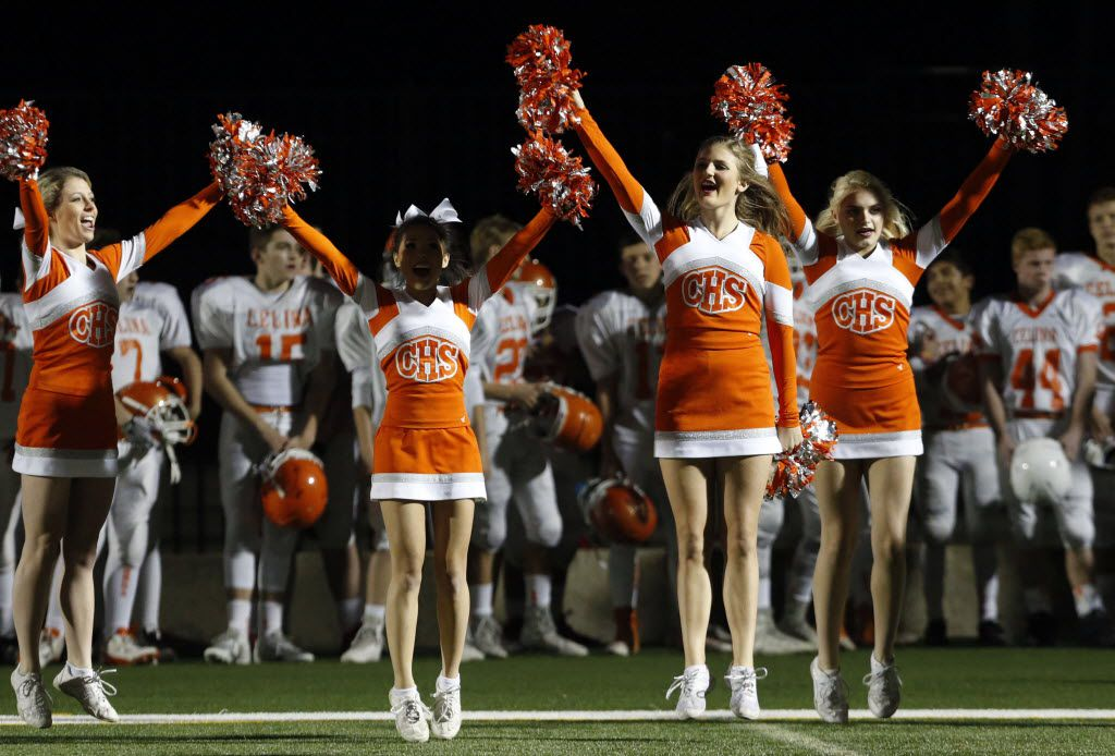 (TXHSFB) Celina High cheerleaders yell in an end zone before the start of a high school football playoff game with Gilmer High on Friday, December 11, 2014. (John F. Rhodes / Special Contributor)