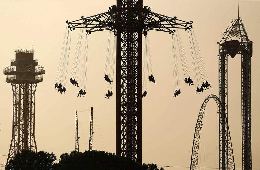 Six Flags Over Texas visitors rode the Texas SkyScreamer, the world's tallest swing carousel ride, as Saharan dust carried here from Africa caused hazy skies across Arlington on June 30, 2018.