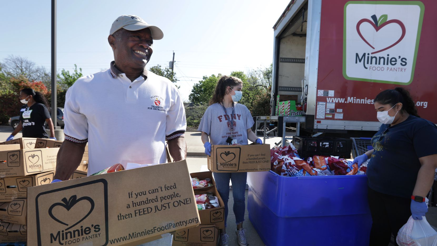 Volunteers with Minnie's Food Pantry pass out groceries at Meadows Elementary School. The Plano-based group is partnering with McKinney ISD to help families who need food assistance as the coronavirus pandemic continues.